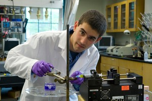 <p>Honors student David Lindsay at work in a chemistry lab. Photo by Lanny Nagler</p>