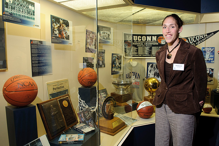 <p>Former Women's Basketball star Rebecca Lobo visits the J. Robert Donnelly Husky Heritage Sports Museum, seeing an exhibit that includes her accomplishments at UConn for the first time. Photo by Peter Morenus</p>
