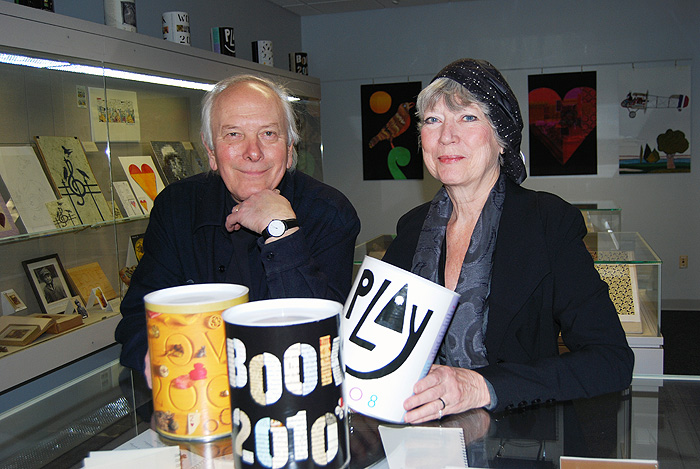 <p>Peter Good '65 and Jan Cummings Good '66 during the installation of their calendar exhibit at the Dodd Center. The Goods created the UConn oakleaf logo. Photo by Suzanne Zack</p>