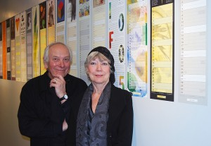 <p>Peter Good '65 and Jan Cummings Good '66 with their calendar exhibit at the Dodd Center. The exhibit runs through March 5. Photo by Suzanne Zack</p>