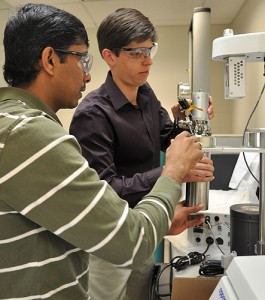 <p>Dr. Alex Agrios (right) and Civil and Environmental Engineering graduate student Venkata Manthina, set up a new high pressure reactor in the C2E2 lab. Photo by Brianna Diaz</p>