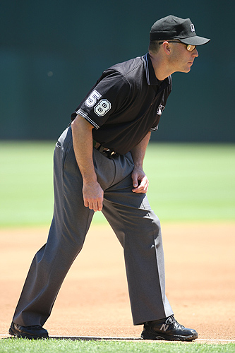 <p>Third base umpire Dan Iassogna #58 looks on during the game between the Boston Red Sox and the Oakland Athletics at the McAfee Coliseum in Oakland, California on June 7, 2007.  The Red Sox defeated the Athletics 1-0.  Photo by Brad Mangin</p>