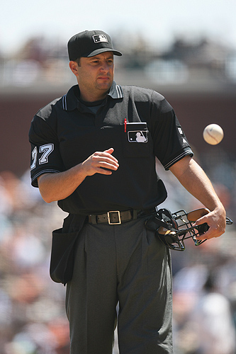 <p>Umpire Jim Reynolds stands on the field during the game between the San Francisco Giants and the Arizona Diamondbacks at AT&T Park in San Francisco, California. Photo by Brad Mangin</p>