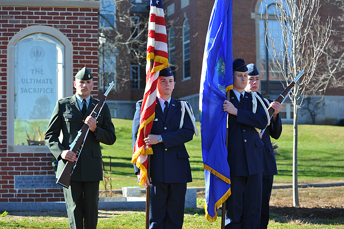 <p>The honor guard retires the colors at the end of the Veteran's Day ceremony held on the lawn in front of the Wilbur Cross Building. Photo by Peter Morenus</p>