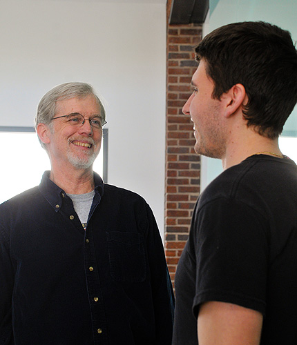 <p>John Morris, professor of Toxicology, talks with Joseph Chichocki, a graduate Toxicology major, in the Pharmacy building. Photo by Jessica Tommaselli</p>
