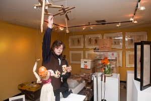 <p>Elizabeth Kelly'14, a history major, helps prepare the exhibits honoring the late Frank Ballard at the Ballard Institute and Museum of Puppetry. Photo by Sean Flynn</p>