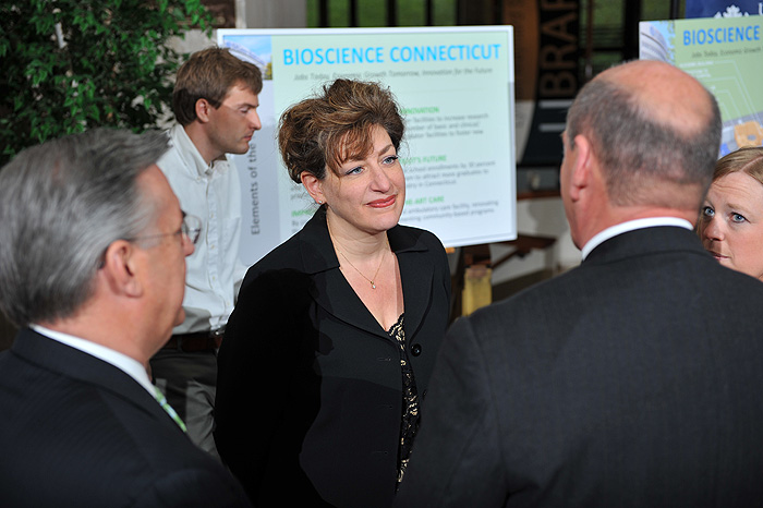 <p>President designate Susan Herbst speaks with legislators after a a press conference held at the UConn Health Center to announce Bioscience Connecticut on May 17, 2011. Photo by Peter Morenus</p>