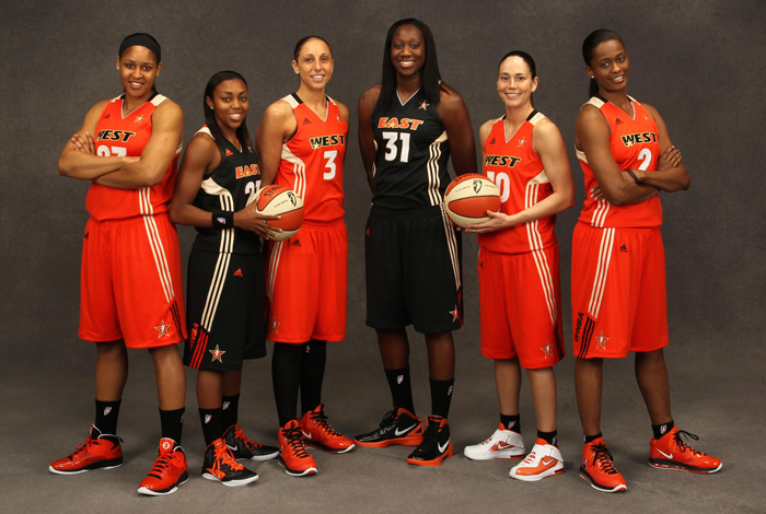 The 2011 WNBA All-Star game in San Antonio on July 15 served as a reunion for six former Huskies. From left: Maya Moore'11 (CLAS) of the Minnesota Lynx, Renee Montgomery '09 (CLAS) of the Connecticut Sun, Diana Taurasi '05 (CLAS) of the Phoenix Mercury, Tina Charles '10 (CLAS) of the Connecticut Sun, Sue Bird '02 (CLAS) and Swin Cash '02 (CLAS), both of the Seattle Storm. Cash was named the Most Valuable Player of the WNBA All-Star Game. During a separate ceremony noting the league's 15th year, Bird and Taurasi were honored as two of the Top 15 players of all-time. (NBAE/Getty Images)