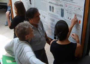 Graduate school faculty Dr. Carol Pilbeam and Leonardo Aguila talk with doctorate in biomedical science student Mathilde Bonnemaison about her research.