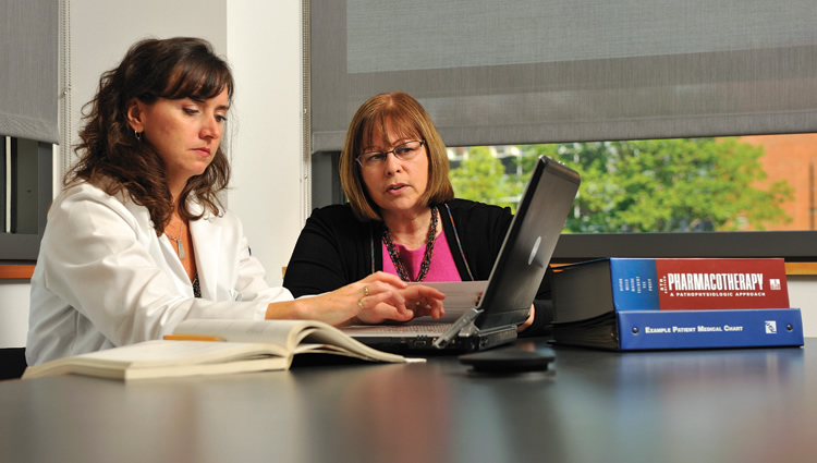 Lisa Bragaw, field coordinator, left, and Marie Smith, professor of pharmacy.