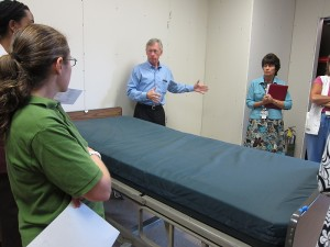 Neil Alcorn with SBA/HKS Architects answers questions about the patient room mock-up. (Jennifer Beardsley/UConn Health Center Photo)
