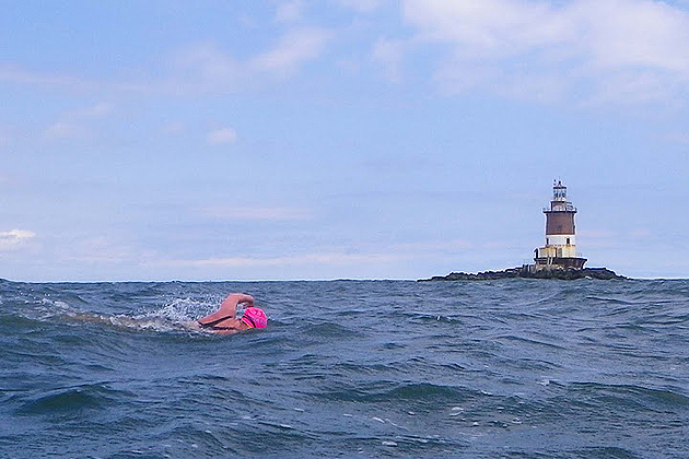 Liz Fry swimming past Romer Shoal Light on her way to Sandy Hook, NJ on the outbound leg of her round-trip Ederly swim. (Vladimir Brezina photo)