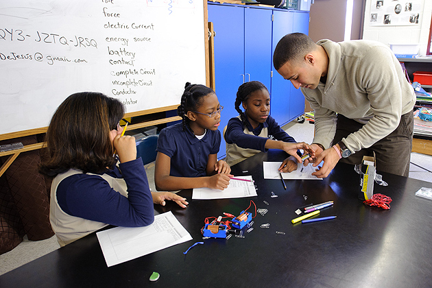Fourth-graders perform an electromagnetic experiment with the help of their teacher Freddie DeJesus at Dr. Joseph S. Renzulli Gifted and Talented Academy in Hartford on Dec. 14, 2011. (Peter Morenus/UConn Photo)