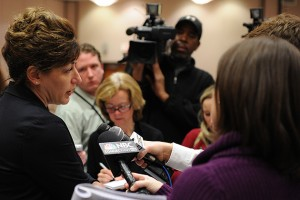 President Susan Herbst, left, speaks with the media about the tuition increase to fund the hiring of 290 new professors, after the Board of Trustees meeting on Dec. 19. (Peter Morenus/UConn Photo)