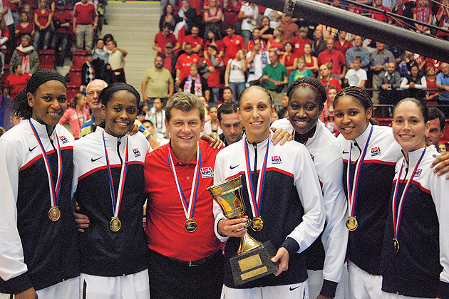 Geno and UConn players with medals.