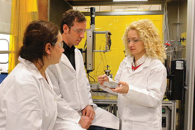 Radenka Maric, Connecticut Clean Energy Fund Professor of Sustainable Energy, right, in the lab with Justin Roller, center, a graduate student and Mirela Dragan, a postdoctoral fellow, on Jan. 23, 2012. (Peter Morenus/UConn Photo)