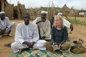 Actor and humanitarian Mia Farrow sits with Darfuri men at the Gouroukoum Camp, 2007