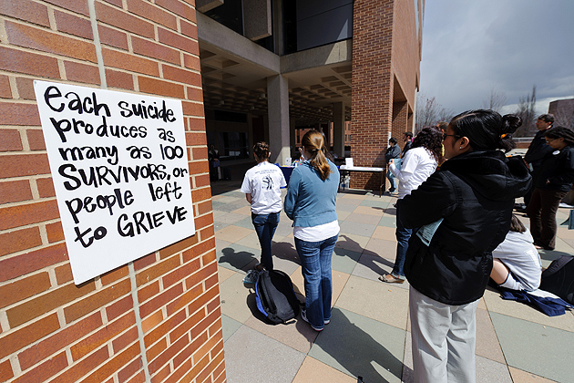 A poster hanging outside the Homer Babbidge Library draws attention to the widespread effects of suicide on family and friends who have lost a loved one. (Peter Morenus/UConn Photo)