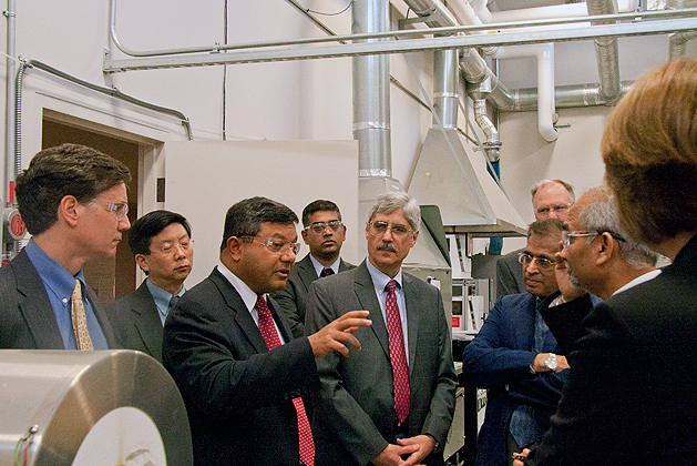 Arun Majumdar, acting under secretary of energy in the US Department of Energy toured UConn's Center for Clean Energy Engineering at the Depot Campus. He was accompanied by Daniel Esty (far left), commissioner of the Conn Department of Energy and Environmental Protection. (Orlando Echevarria/UConn Photo)