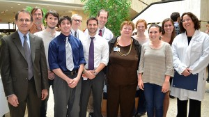 (left to right)  Dr. Dan Henry, Dr. James Watras, student presenters Greg Salber and Zac Cavanaugh, Dr. Richard Zeff, student presenter Will Gionfriddo, Dr. Raymond Foley, Dr. Melinda Sanders, student presenters Katie Schultz, Jenna Bernstein, Niki Albino, and Dr. Louise McCullough. (Tina Encarnacion/UConn Health Center Photo)