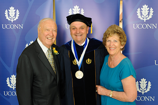 Richard L. Schwab, center, with Ray '56 (CLAS) and Carole Neag after a ceremony held at the Charles B. Gentry Building to invest Schwab as Neag Professor on June 7. (Peter Morenus/UConn Photo)