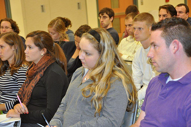 Students in the Neag School of Education's Teacher Certification Program for College Graduates attending a forum at UConn's Waterbury campus on the state's education reform had many questions about the new laws. (Shawn Kornegay/UConn Photo)