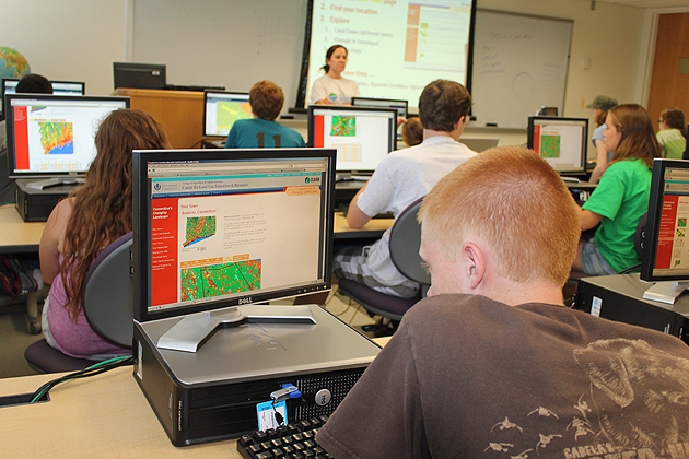 Classroom exercises taught by department of extension specialists  introduced Hunter Browning from Preston (foreground) and fellow students to GIS/GPS technology. (Susan Schadt/UConn Photo)