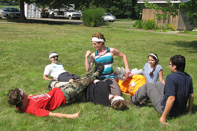 Ethan Yarish, center, from Oakdale 'rows the boat' in a team-building exercise. (Sheila Foran/UConn Photo)