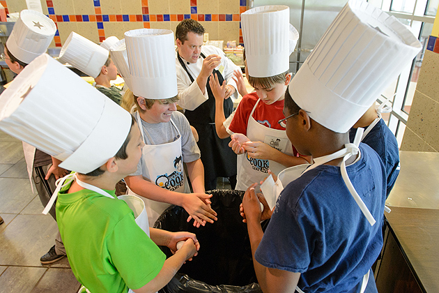 Breaking eggs using in their bare hands ... a favorite trick of chefs ... isn't as easy as it looks.(Peter Morenus/UConn Photo)