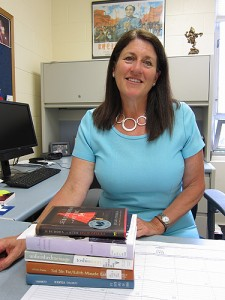 Christine Reardon in her office at the Torrington campus with books about East Asia. (Cindy Weiss/UConn Photo)