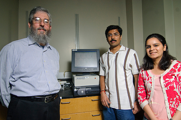From left: James Rusling, professor of Chemistry, Bhaskara Chikkaveeraiah and Ruchika Malhotra in their lab in the Chemistry building. (UConn Photo / Jessica Tommaselli)