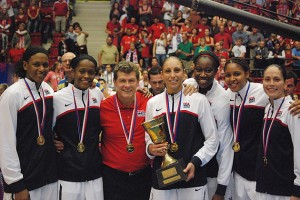 Six former Huskies and head coach Geno Auriemma are part of the 2012 U.S. Olympic Women's Basketball Team competing in London this month. From left: Asjha Jones, Swin Cash, Coach Auriemma, Diana Taurasi, Tina Charles, Maya Moore, and Sue Bird. (Photo courtesy of USA Basketball)