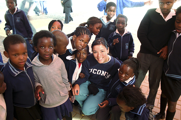 Justina Leung '09 (CANR) with schoolchildren in South Africa, during a Study Abroad program.