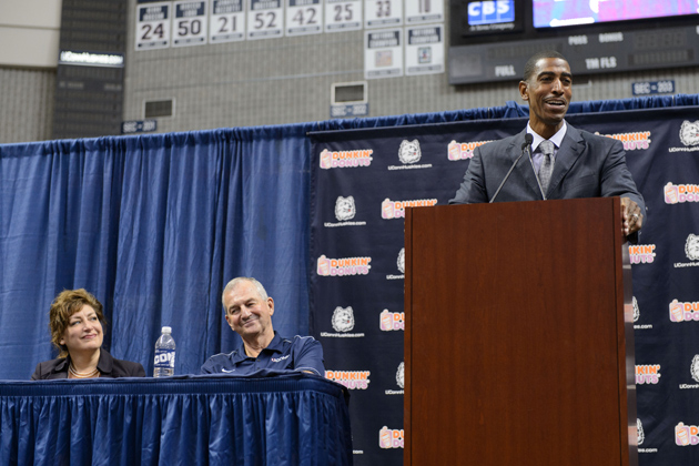 Kevin Ollie, right, speaks at the press conference. (Peter Morenus/UConn Photo)