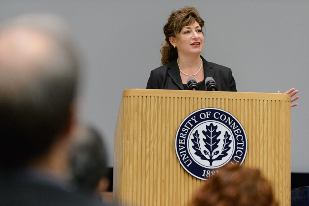 President Susan Herbst gives opening remarks at the UConn/JAX Genomics Symposium, held at the Student Union Theater on Sept. 6. (Peter Morenus/UConn Photo)