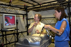 Don Peterson and Dr. Angela Kueck, medical director of the Health Center's robotic surgery program, performing an experiment in the Biodynamics Laboratory.