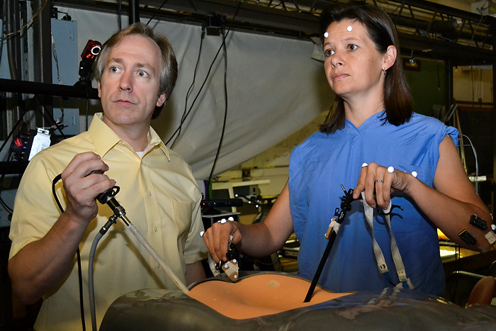 Don Peterson and Dr. Angela Kueck are collaborating on a study looking at ways to reduce a surgeon's pain and fatigue while performing laparoscopic surgery.