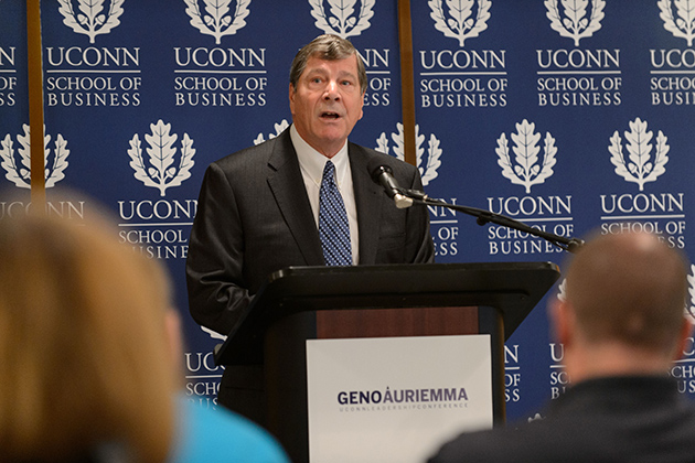 John Elliott, dean of the School of Business, speaks during the press conference. The Geno Auriemma UConn Leadership Conference is a joint program with the business school. (Peter Morenus/UConn Photo)