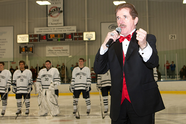 Rene Rancourt, who has sung the U.S. and Canadian national anthems before Boston Bruins games for 35 years, sang the national anthem in Storrs during the 2011 UConn Hockey Classic. (Steve Slade '89 (SFA) for UConn)