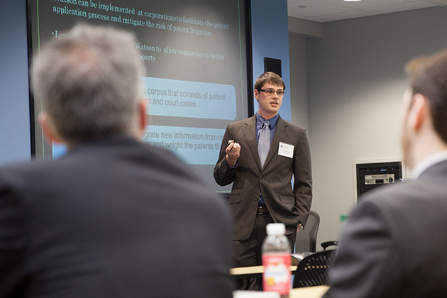 Donald Butts '13 MBA, an engineer pursuing his master's at UConn-Stamford, explains a proposal to IBM executives on how its Watson computing system could be used in the pharmaceutical industry. (Zach Wussow for UConn)