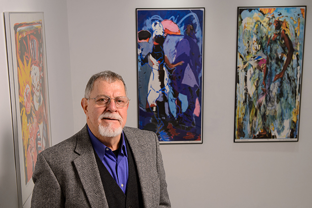 Gus Mazzocca, professor emeritus of art and art history, with a retrospective exhibit of his art at the Contemporary Art Gallery at the Fine Arts Building on Jan. 24, 2013. (Peter Morenus/UConn Photo)