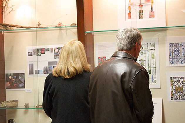 At the opening reception for Marlow Shami's exhibit, visitors toured the Whitson Gallery. (Karen Lafleur/UConn Photo)