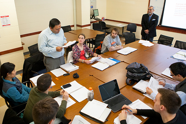 (standing) Vishal Dhagat, Ph.D. student in engineering, talks during a course designed to support graduate students with potential entrepreneurial ideas on Feb. 12, 2013. (Sean Flynn/UConn Photo)