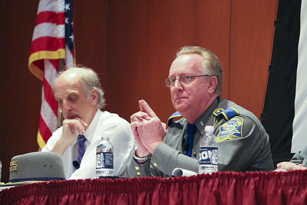 Connecticut State Police spokesperson Lt. J. Paul Vance, right, was the officer whose role was to communicate with the press during the aftermath of the Sandy Hook school shootings. At left is Bill Leukhardt, a longtime Hartford Courant reporter and stepfather of Lauren Rousseau, a 2004 UConn graduate and Sandy Hook Elementary teacher who was killed in her classroom during the shootings. (Christien Buckley/UConn Photo)