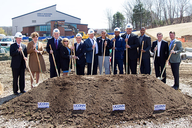 Longtime UConn basketball supporter and major donor Peter Werth (sixth from left) was among the UConn officials and friends who celebrated the groundbreaking for the University's new basketball practice facility in April 2013. (Stephen Slade '89 (SFA) for UConn)