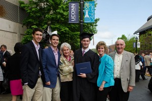 Brian Petroccio '13 (BUS) with his family after the School of Business Commencement ceremony held at Gampel Pavilion on May 12, 2013. (Ariel Dowski '14 (CLAS)/UConn Photo)
