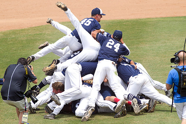 The baseball team piles up during the Big East Tournament game in Clearwater, Fla. The Huskies beat Notre Dame 8-1. (Steve Slade '89 (SFA) for UConn)
