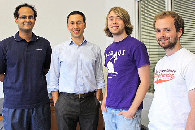 Professor Daniel Schwartz, second from left, with student programmers, from left, Saad Quader, a Ph.D. student in computer science, and undergraduates Joey O'Shea '14 (ENG) and Kevin Ryan '14 (ENG).