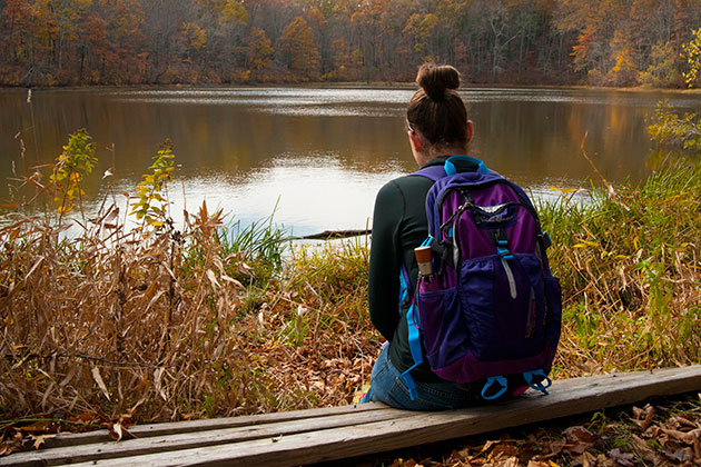 Megan Gauer '16 participates in silent reflection during a field trip to Tift Pond. (Sean Flynn/UConn Photo)