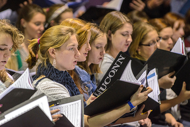 Students from the UConn Concert Choir and UConn Festival Chorus, as well as singers from Farmington and E.O. Smith High Schools, rehearse Beethoven's 9th Symphony in the Music Building on Nov. 18, 2013. (Ariel Dowski/UConn Photo)